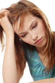 stock photo of sad face  - Young beautiful woman in depression - JPG