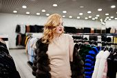 Elegance Blonde Girl In Fur Coat At The Store Of Fur Coats And Leather Jackets. poster