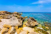 Flooded in the sea near the shore, ruins and remains of ancient forts. Spring day in Israel. Ruins o poster