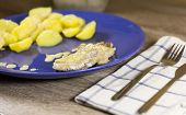 Steamed Fish Filet With Creamy Sauce And Steamed Potatoes  On Blue Plate Napkin And Cutlery On Woode poster