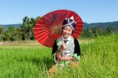 stock photo of hmong  - Portrait Hmong from Laos with parasol and traditional national costume
