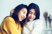 Beautiful Young Asian Women Lgbt Lesbian Happy Couple Sitting On Bed Hugging And Smiling Together In poster