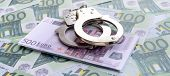 Police Handcuffs Lies On A Set Of Green Monetary Denominations Of 100 Euros. A Lot Of Money Forms An poster