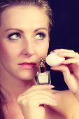Smell, Elegance Concept. Beautiful Elegant Blonde Woman With Holding Perfume Bottle, Studio Shot On  poster