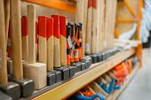 Hardware store assortment, shelf with hammers poster