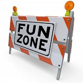 An orange and white construction barricade sign reading Fun Zone to indicate an area set aside for p