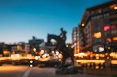 Oslo, Norway. Night Abstract Boke Bokeh Background Effect. Horse Statue On The Street And Residentia poster