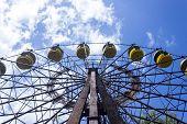 Abandoned Amusement Park. Ferris Wheel In An Amusement Park In Pripyat. Unhappy Childhood. poster