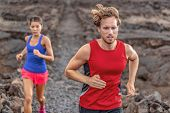 Couple fit athletes runners running jogging outdoor in trail run sport competition. Man and woman jo poster