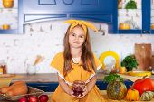 Portrait Of A Little Girl Sitting On Kitchen Table With A Jar Of Jam. Cheerful Child In The Kitchen. poster