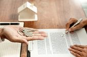 Real Estate Developer Agent And Sign On Document Giving Keys Of New House, Property Agent Giving Off poster