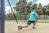 Athletic Man Exercises With Straps Loops Trx, Lunges Workout Leg Muscles, Workout In Summer In City, poster