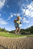 pic of swingset  - Toddler playing on swings at a park - JPG