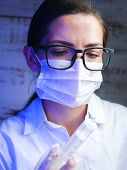 Scientist Works With Harmful Chemicals. A Laboratory Worker Examines Biologically Hazardous Liquids, poster