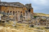 Ancient Antique Amphitheater In The City Of Hierapolis In Turkey. Side View. Steps And Antique Statu poster