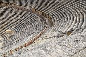 The Steps Of The Amphitheater. Stone Limestone And Marble. Ancient Antique Amphitheater In The City  poster