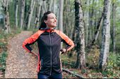 Young White Woman In A Tracksuit In A Forest Park. Preparation For Sports Training And Jogging. poster