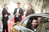 Portrait Of A Man As A Famous Movie Actor Sitting In The Luxury Car, Arriving On The Awards Ceremony poster