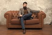 Rent Apartment. Bearded Man With Confident Face Sit Leather Couch. Loft Interior Apartment. Business poster