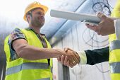 Handshake on the construction site after acceptance poster