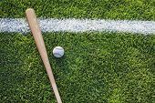 Baseball Bat And Ball On Grass Field Viewed From Above