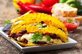 stock photo of tacos  - taco with chili con carne in a bowl - JPG