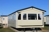 Exterior of modern static caravan in trailer park, England.