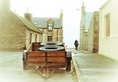 picture of street-walker  - A wooden trailer on a scottish street in the winter fog - JPG