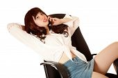 Young Woman Sits On Armchair With Mobile Phone