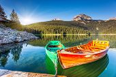 pic of wonderful  - Reflection in water of mountain lakes and boats - JPG