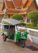 BANGKOK - FEBRUARY 20: Tuk-tuk moto taxi on the street near Wat Saket temple on February 20, 2012 in