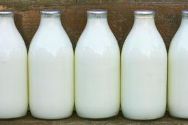 foto of milkman  - milk bottles standing on a doorstep after delivery - JPG