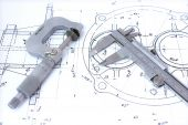 stock photo of micrometer  - Micrometer and caliper on blueprint horizontal - JPG