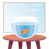 Goldfish in aquarium on table
