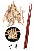 Licorice root chinese herbal medicine with mandarin title script translation and chopsticks. Gan cao