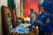 AMPANG - OCTOBER 9: Unidentified Chinese Opera actresses make up before their act at the Kau Ong Yah Temple in Ampang, Malaysia on October 9, 2013; celebrating the nine emperor gods festival.