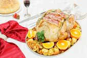 Roasted  turkey with turkey frills on festive table