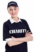 pretty charity worker with arms crossed on white background