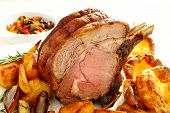 Roast Rib Of Beef With Roasted Vegetables On White Background