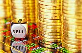 Golden Coins, Financial Chart And Dices Cube With The Word Sell. Selective Focus