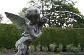 picture of ero  - Garden Eros fountain spurting water into pond - JPG