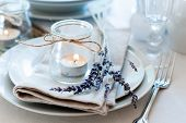 stock photo of crockery  - Dining table setting at Provence style with candles lavender vintage crockery and cutlery closeup - JPG
