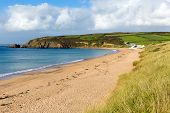 Beach at Praa Sands Cornwall England on the South West Coast Path blue sky and sea