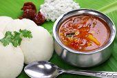 idli, sambar, coconut and lime chutney, south indian breakfast on banana leaf