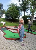 foto of miniature golf  - Three hillybilly looking kids playing miniature golf - JPG
