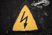 Old Weathered Yellow High Voltage Sign