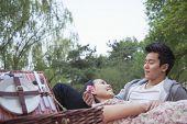 Smiling couple in love having picnic in the park