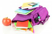 stock photo of knapsack  - Purple backpack with school supplies isolated on white - JPG