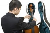 Musician Opening A Cello Case