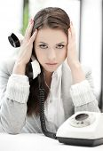 business concept - stressed and tired businesswoman with cell phone